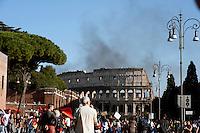 Roma  15 Ottobre 2011.Manifestazione contro la crisi e l'austerità.Il fumo degli incendi avvolge il Colosseo