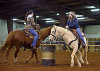 NWA Democrat-Gazette/BEN GOFF -- 02/01/15 Ashli Clary (left) of Siloam Springs and Sidney Tisdale of Fayetteville practice a 'do-si-do' maneuver as the Rodeo of the Ozarks Rounders practice in Isuba Valley Horse Park near Siloam Springs on Sunday, Feb. 1, 2015.