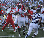 Jacksonville State's Chris Nesbitt (52) and Tori Mobley (69) celebrate at Vaught-Hemingway Stadium in Oxford, Miss. on Saturday, September 4, 2010. Jacksonville State won 49-48 over Mississippi in double overtime. (AP Photo/Oxford Eagle, Bruce Newman)