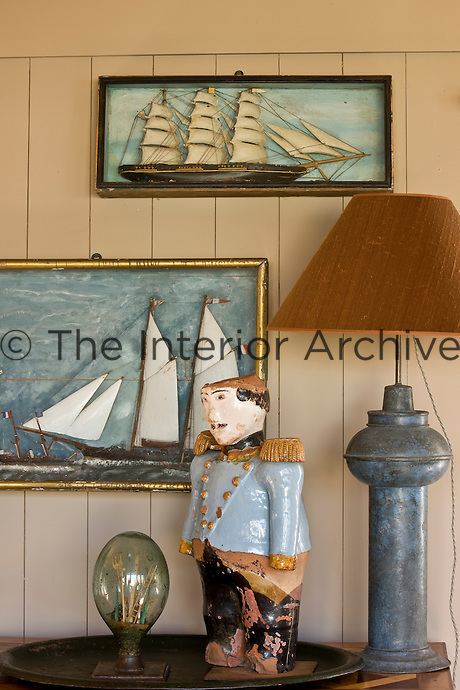 On a side table in the living room the tubby ceramic figure standing to attention is General Tanpousse