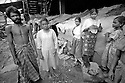 Slum dwellers. A family and their home on a slum extending under a Kolkata bridge.