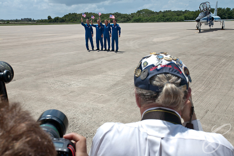 The crew of Space Shuttle Atlantis's pose for photographs after arriving at Kennedy Space Center on Monday, July 4, 2011.  Picutred (from left) are Commander Chris Ferguson, Pilot Doug Hurley and Mission Specialists Sandy Magnus and Rex Walheim. Atlantis' mission is the final one of the program's 30 year history.