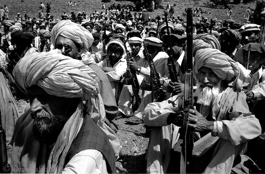 barwaiz raghzai, south wazisitan, april 2004: a tribal lashkar gathers in the foothills of south waziristan.  the lashkar has been called together to track down suspected al qaeda fighters and collaborators thought to be hiding in the moutainous regions between pakistan and afghanistan.<br />