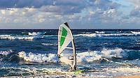 A windsurfer coming in to shore at Ho'okipa Beach on Maui.
