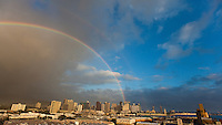 View of Dole Cannery and downtown Honolulu from above, with a double rainbow in the background