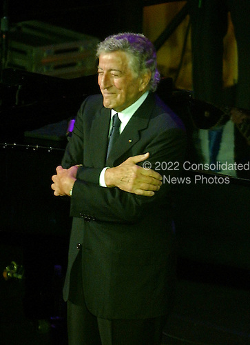 """Washington, D.C. - January 4, 2007 --  Tony Bennett thanks the crowd for their applause after a performance at the """"Swearing-in Celebration Concert"""" for U.S. House Speaker Nancy Pelosi at the National Building Museum in Washington, D.C. on Thursday, January 4, 2007..Credit: Ron Sachs / CNP"""