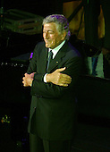 "Washington, D.C. - January 4, 2007 --  Tony Bennett thanks the crowd for their applause after a performance at the ""Swearing-in Celebration Concert"" for U.S. House Speaker Nancy Pelosi at the National Building Museum in Washington, D.C. on Thursday, January 4, 2007..Credit: Ron Sachs / CNP"
