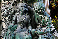 Close-up view of Paul et Virginie from the statue of Bernardin de Saint Pierre, created by Louis Holweck (1861-1935) and located in the Jardin des Plantes, Paris, 5th arrondissement, France. Founded in 1626 by Guy de La Brosse, Louis XIII's physician, the Jardin des Plantes, originally known as the Jardin du Roi, opened to the public in 1640. It became the Museum National d'Histoire Naturelle in 1793 during the French Revolution.