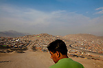 A man looks over the landscape on Tuesday, Apr. 14, 2009 in Ventanilla, Peru.