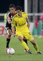 WASHINGTON, DC - OCTOBER 20, 2012:  Marcelo Saragosa (11) of D.C United tackles Milovan Mirosevic (10) of the Columbus Crew during an MLS match at RFK Stadium in Washington D.C. on October 20. D.C United won 3-2.