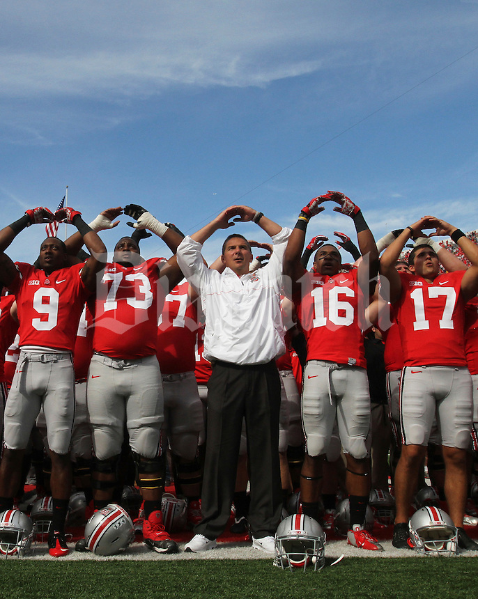Ohio State Buckeyes head football coach Urban Meyer with his team during the singing of Carmen Ohio after his NCAA football game against the California Golden Bears at the Ohio Stadium, September 15, 2012.  (Columbus Dispatch Photo by Neal C. Lauron)