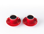 Two red espresso coffee cups isolated on white background