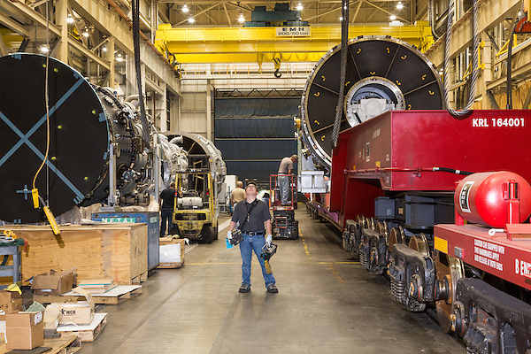 July 6, 2016. Greenville, South Carolina. <br />  A worker awaits the arrival of the crane that will help move the turbine as he and other GE employees get ready to ship the turbine via train car. <br />  At the General Electric Gas Turbine factory, engineers  design, produce, test and repair gas turbines for generating electricity. These turbines weigh more than 900,000 pounds and can create internal combustion temperatures up to 2,900 degrees F. Depending on the model, one of the GE turbines can produce enough electricity for half a million American households.