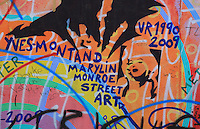 Section of the Berlin Wall covered in graffiti including a Marilyn Monroe stencil, part of the East Side Gallery, a 1.3km long section of the Wall on Muhlenstrasse painted in 1990 on its Eastern side by 105 artists from around the world, Berlin, Germany. Picture by Manuel Cohen