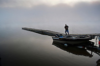 Fisherman pulls his boat from the trailer at one of the docks on Hoover Reservoir on a foggy Saturday morning.