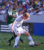 CARSON, CA - June 17, 2012: Portland Timbers defender Hanyer Mosquera (33) and LA Galaxy forward Jack McBean (32) during the LA Galaxy vs Portland Timbers match at the Home Depot Center in Carson, California. Final score LA Galaxy 1, Portland Timbers 0.