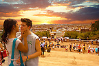Young couple about to kiss on the steps of the Sacré-Coeur Basilica, Montmartre, Paris at sunset