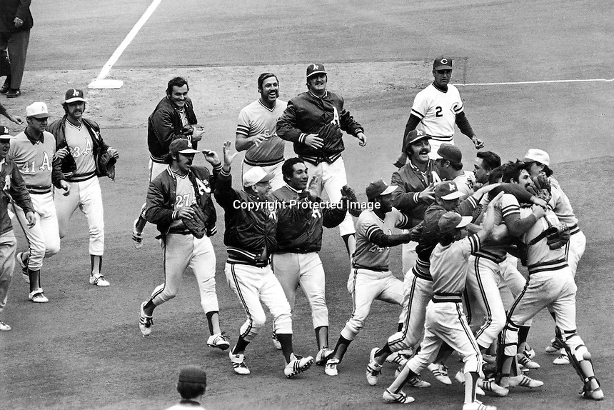 Closer Rollie Fingers in mobbed by his teammates following the last out of the 1972 World Series. The <br /> Oakland Athletics defeated the Cincinnati Reds in 7 games.