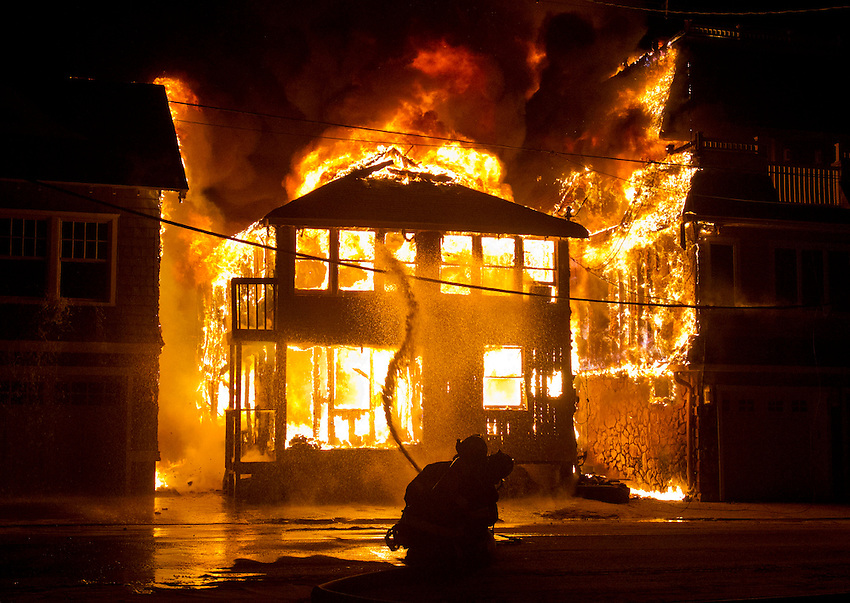 MANASQUAN, NJ (Dec. 5, 2012) —Firefighters can do little as flames spread from a fully-involved bungalow on First Avenue, here, during an early morning blaze that heavily damaged or destroyed 12 homes on the Manasquan beachfront.