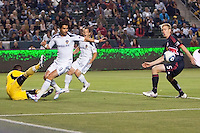 NY Red Bulls defender Tim Ream (5) and LA Galaxy forward Juan Pablo Angel (9) move to the ball as Red Bulls goal keep Bouna Coundoul (18) lies on the the ground. The LA Galaxy and Red Bulls of New York played to a 1-1 tie at Home Depot Center stadium in Carson, California on  May 7, 2011....
