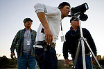 From left, Minutemen volunteers Bill Maddux, Steve Callagy, and Paul Baker use an infrared scope to watch for illegal migrants near Campo, CA on Wednesday, April 12, 2006.<br />