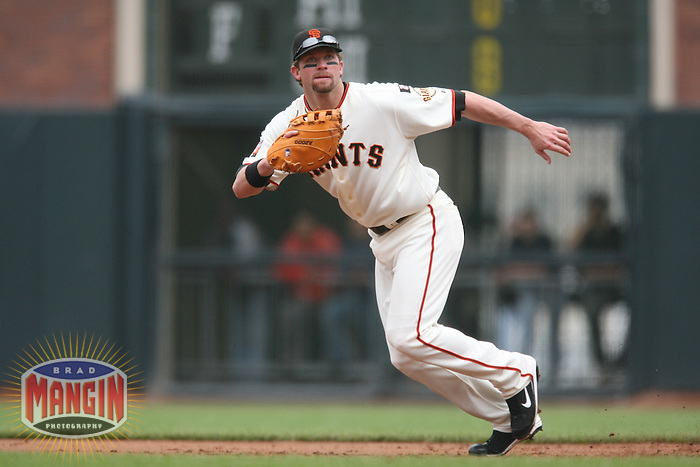 SAN FRANCISCO - SEPTEMBER 23:  Daniel Ortmeier of the San Francisco Giants plays defense at first base during the game against the Cincinnati Reds at AT&T Park in San Francisco, California on September 23, 2007.  The Giants defeated the Reds 5-4.  Photo by Brad Mangin