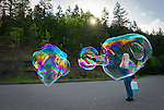 "The ""Bubble Lady of Sequim"" works her bubble magic along the highway to Hurricane Ridge, on a warm, sunny spring day."