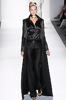 Model walks runway an EBONY SILK OTTOMAN FLOOR-LENGTH SMOKING COAT W/BEADED HOUSE OF TOI CREST LINING,  EBONY COUTURE SILK SATIN EVENING SHIRT, AND EBONY SILK OITIOMAN HIP-HUGGNG LEAN TROUSERS W/ SATIN WAISTBAND by Zang Toi, for the Zang Toi Spring 2012 My Dream Of North Africa Collection, during Mercedes-Benz Fashion Week Spring 2012.