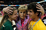 01 APRIL 2012:  Head Coach Kim Mulkey of Baylor University celebrates with her children Kramer and Mackenzie Robertson after defeating Stanford University during the Division I Women's Final Four semifinals at the Pepsi Center in Denver, CO.  Baylor defeated Stanford 59-47 to advance to the championship final.  Jamie Schwaberow/NCAA Photos