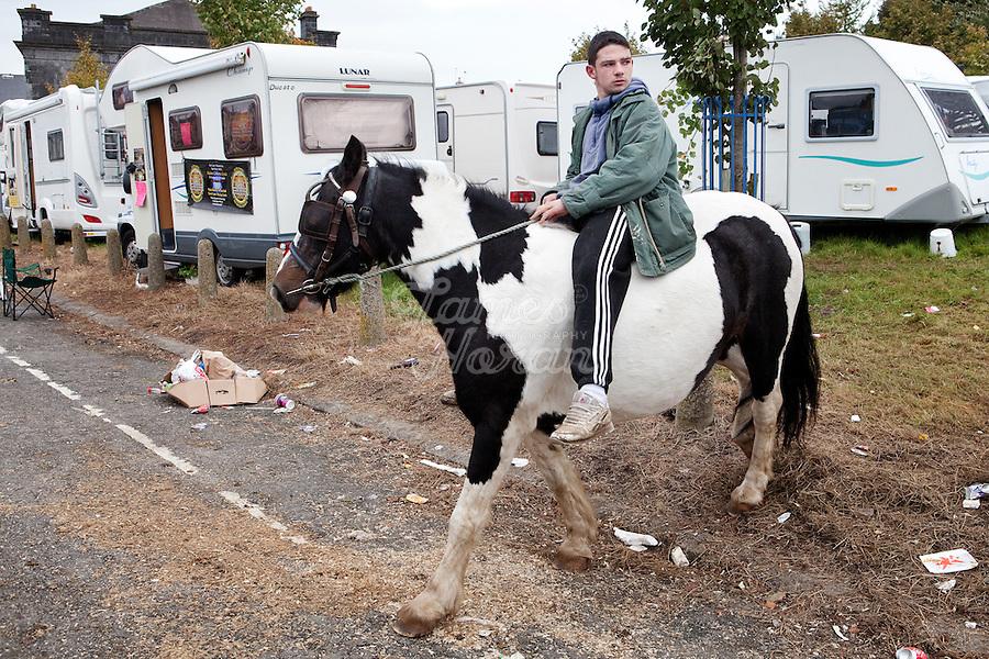 4/10/2010. A traveler boy rides his horse near the camp site at the Ballinasloe Horse Fair, Ballinasloe, Ireland. Picture James Horan