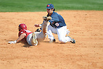 Alabama's Austen Smith (18) is tagged out by Ole Miss' Blake Newalu (6) at Oxford-University Stadium in Oxford, Miss. on Sunday, March 20, 2011. Alabama won 6-4.