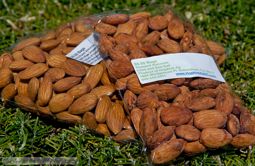 Two bags of almonds from Hopkin's Ag; the roasted lime and sea salt were delicious.  Contrast them with the raw almonds to see the color change that comes with roasting.