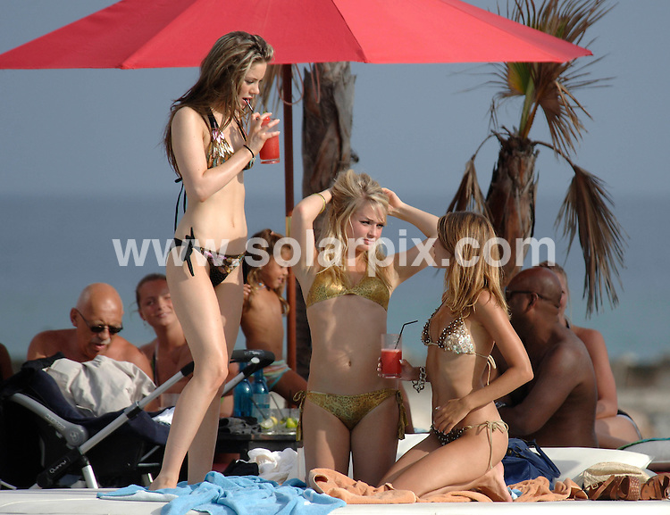 **ALL ROUND PICTURES FROM SOLARPIX.COM**.**WORLDWIDE SYNDICATION RIGHTS**.Pics show Hollyoaks girls on holiday in Marbella. .Emma Rigby (Hannah Ashworth in show) and Roxanne McKee (Louise Summers) drank coctails while they soaked up the sun at the Osean Club in Puerto Banus..JOB REF:  4572    AB1 / JGS  DATE: 24.08.07.**MUST CREDIT SOLARPIX.COM OR DOUBLE FEE WILL BE CHARGED* *UNDER NO CIRCUMSTANCES IS THIS IMAGE TO BE REPRODUCED FOR ANY ONLINE EDITION WITHOUT PRIOR PERMISSION*