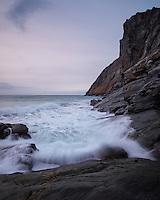 Waves crash against rocky coastline at Kvalvika beach, Moskenesøy, Lofoten Islands, Norway