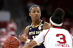 29 December 2016: Notre Dame's Lindsay Allen (15) and NC State's Miah Spencer (3). The North Carolina State University Wolfpack hosted the University of Notre Dame Fighting Irish at Reynolds Coliseum in Raleigh, North Carolina in a 2016-17 NCAA Division I Women's Basketball game. NC State won the game 70-62.