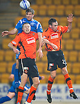 St Johnstone v Dundee United....22.02.11 .Jamie Adams climbs above Timothy Van der Meulen.Picture by Graeme Hart..Copyright Perthshire Picture Agency.Tel: 01738 623350  Mobile: 07990 594431