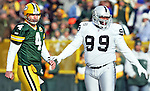 (2007)-Green Bay Packers' Brett Favre and Oakland Raiders' Warren Sapp after Brett Favre threw an interception on a ball intended for Koren Robinson in the 1st quarter. .The Green Bay Packers hosted the Oakland Raiders at Lambeau Field Sunday December 9, 2007. Steve Apps-State Journal.