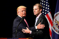 Ashburn, VA - August 2, 2016: Donald Trump and his son, Eric Trump, embrace during a campaign event in Ashburn, VA., August 2, 2016, as his father, republican presidential candidate and businessman Donald J. Trump, looks on.  (Photo by Don Baxter/Media Images International)