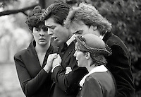 Pix: Copyright Anglia Press Agency/Archived via SWpix.com. The Bamber Killings. August 1985. Murders of Neville and June Bamber, daughter Sheila Caffell and her twin boys. Jeremy Bamber convicted of killings serving life...copyright photograph>>Anglia Press Agency>>07811 267 706>>..Jeremy Bamber is comforted by his girlfriend Julie Mugford, alongside Colin Caffell, father and husband of victims, at funeral. no date..ref 0006 neg 23...