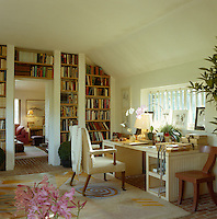 Designer John Stefanidis' home office is located in a book-lined corridor in a wing of his country house which connects the dining room with the pink sitting room