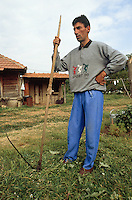 Kosovo. Village of Gaglavica. A serb man, a farmer, holds a scythe in his hand. Farmhouse and buildings. Kosovo (Albanian: Kosova) is a province of Serbia. While Serbia's sovereignty is recognised by the international community, in practice Serbian governance in the Kosovo province is virtually non-existent.  &copy; 1995 Didier Ruef