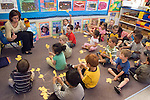 Berkeley CA  Teacher directing students in counting song using chick models to demonstrate addition and subtraction.
