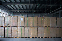 "Boxes of paper sit in an Amity Printing Company warehouse filled in the new printing facility in Nanjing, China...On May 18, 2008, the Amity Printing Company in Nanjing, Jiangsu Province, China, inaugurated its new printing facility in southern Nanjing.  The facility doubles the printing capacity of the company, now up to 12 million Bibles produced in a year, making Amity Printing Company the largest producer of Bibles in the world.  The company, in cooperation with the international organization the United Bible Societies, produces Bibles for both domestic Chinese use and international distribution.  The company's Bibles are printed in Chinese and many other languages.  Within China, the Bibles are distributed both to registered and unregistered Christians who worship in illegal ""house churches."""