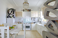 The light and spacious kitchen of the hotel is also a showcase for sculpture and other works of art