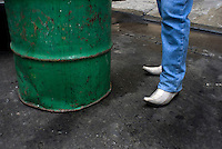 The right-hand man of the leader for the Union of Garbage Colectors; Ruben Chavez Franco (whoes official  title is that of Secretary of Special Events) stands next to a garbage can in the wealthy Mexico City neighbourhood of Polanco.  Mexico DF, 09-08-07