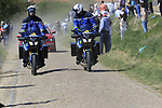 Gendarmes on motocross bikes at the head of the race on pave sector 25 Briastre a Solesmes during the 115th edition of the Paris-Roubaix 2017 race running 257km Compiegne to Roubaix, France. 9th April 2017.<br /> Picture: Eoin Clarke | Cyclefile<br /> <br /> <br /> All photos usage must carry mandatory copyright credit (&copy; Cyclefile | Eoin Clarke)