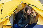 A woman sits in a tent with her dog, Sangre de Cristo Wilderness, San Isabel National Forest, Colorado