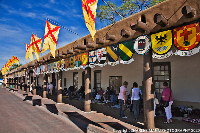 A traditional part of the festivities at the annual Santa Fe Fiesta, the Sunday Procession starts at the Palace of the Governors and moves around the plaza and up to the St. Francis Cathedral. Tratditional Coats of Arms are hung at the Palace of the Governors.