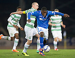 St Johnstone v Celtic.....26.12.13   SPFL<br /> Nigel Hasselbaink and Scott Brown battle<br /> Picture by Graeme Hart.<br /> Copyright Perthshire Picture Agency<br /> Tel: 01738 623350  Mobile: 07990 594431