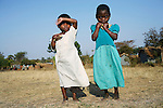 RImages MPHANDULA, MALAWI - AUGUST 20: Unidentified children walk to a pre-school for orphans on August 20, 2006 in Mphandula village, about 30 miles outside Lilongwe, Malawi. Mphandula is a poor village in Malawi, without electricity or clean water. Nobody owns a car or a mobile phone. Most people live on farming. About 7000 people reside in the village and the chief estimates that there are about five-hundred orphans. Many have been affected by HIV/Aids and many of the children are orphaned. A foundation started by Madonna has decided to build an orphan center in the village through Consol Homes, a Malawi based organization. Raising Malawi is investing about 3 million dollars in the project and Madonna is scheduled to visit the village in October 2006. Malawi is a small landlocked country in Southern Africa without any natural resources. Many people are affected by the Aids epidemic. Malawi is one of the poorest countries in the world and has about 1 million orphaned children. (Photo by Per-Anders Pettersson)
